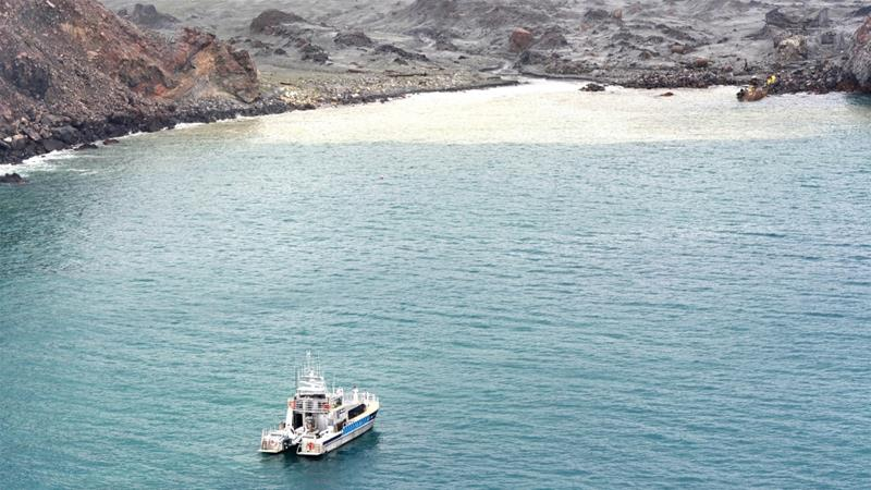 Police believe one of the missing bodies was sighted in the water close to the island by rescue teams on Tuesday, the day after the eruption [Handout Photo: New Zealand Defence Force via AFP]