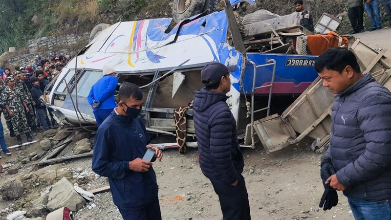 The bus veered off a highway and rolled down a steep slope in the latest deadly traffic accident in Nepal [Pralhad Ghimire/AFP]