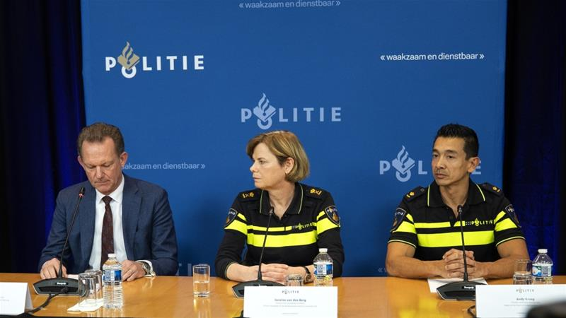 Dutch officials speak to the press after the announcement of the arrest of Ridouan Taghi [Jeroen Jumelet/AFP]