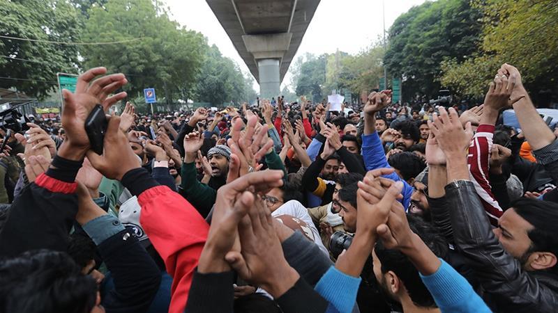 Protesters shout slogans outside the Jamia Millia Islamia university in New Delhi [Rajat Gupta/EPA]