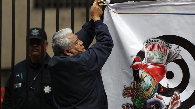 A small protest against the murder and disappearance of journalists in Mexico was recently held [Rebecca Blackwell/AP]