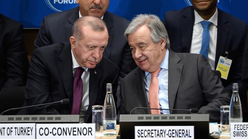 UN Secretary-General Antonio Guterres, right, speaks with Turkey's President Recep Tayyip Erdogan during the opening of the Global Refugee Forum [Fabrice Coffrini/AFP]