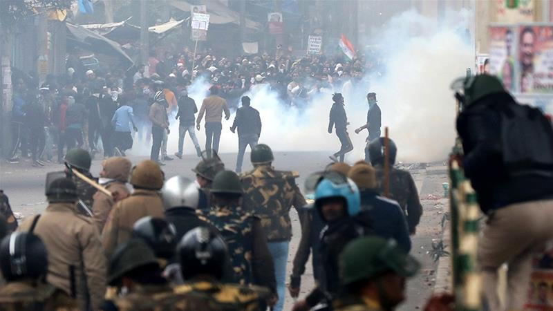 Protesters clash with security forces during a protest against Citizen Amendment Act in New Delhi [Rajat Gupta/EPA]