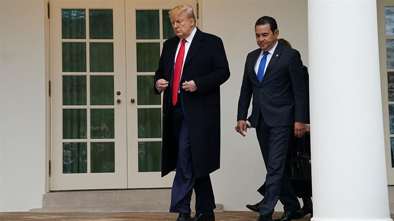 Trump walks with Morales on the West Wing colonnade shortly after the Guatemalan president's arrival at the White House [Kevin Lamarque/Reuters]