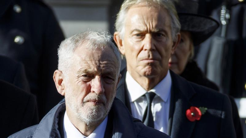 Former Prime Minister Tony Blair, right, stands behind UK's opposition Labour Party leader Jeremy Corbyn at the Remembrance Sunday ceremony at the Cenotaph on Whitehall in central London, on November 11, 2018 [File: Tolga Akmen/AFP]