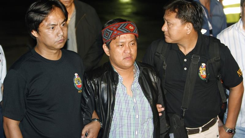 Andal Ampatuan Jr, centre, has denied any responsibility for the mass killings [Reuters]