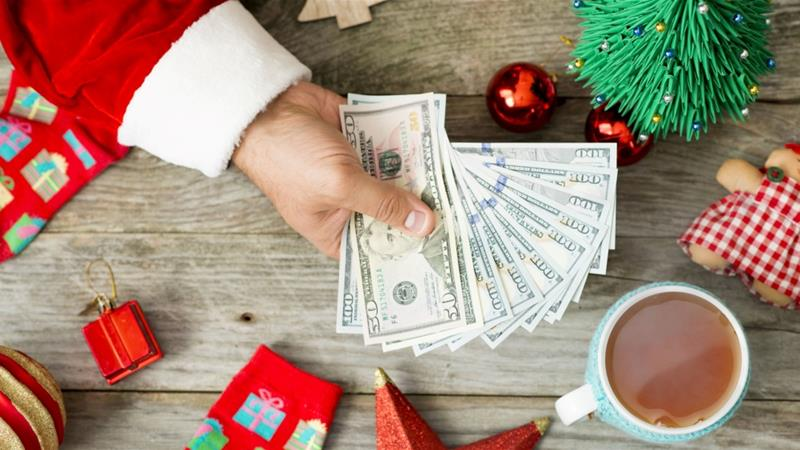 Almost half of US shoppers say they will pay for their holiday purchases with a credit card, a recent survey finds [iStock/Getty Images Plus]