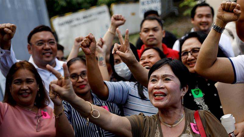 Relatives of victims of the 2009 Maguindanao massacre celebrate after the verdict in Taguig City on Thursday [Eloisa Lopez/Reuters]
