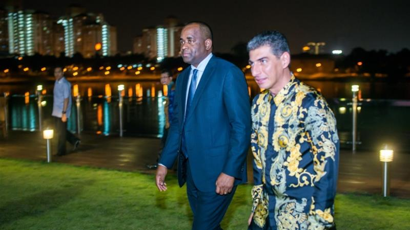 Dominican Prime Minister Roosevelt Skerrit (left) and Ali Reza Monfared, the man who bought a diplomatic passport [Al Jazeera]