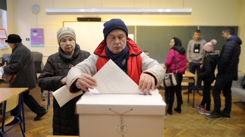 A man casts his ballot at a polling station during the presidential election in Zagreb, Croatia [Antonio Bronic/Reuters]