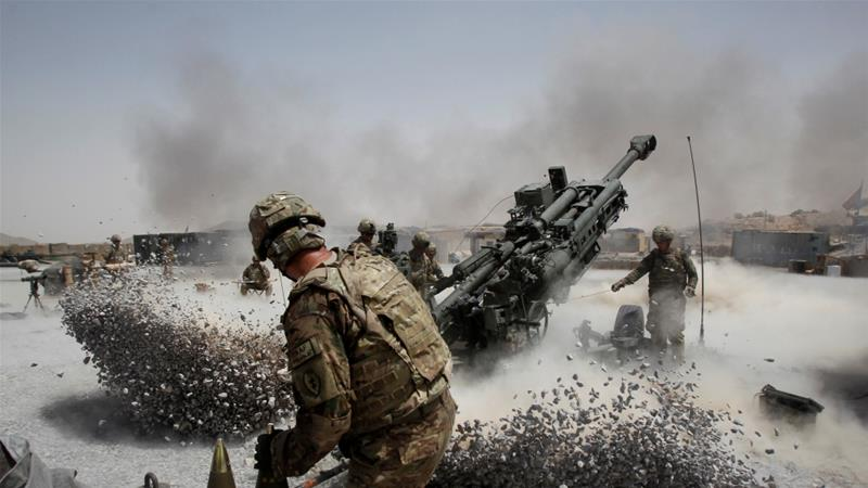 US army soldiers fire a howitzer artillery piece at Seprwan Ghar forward fire base in Panjwai district, Kandahar province in southern Afghanistan on June 12, 2011 [File: Baz Ratner/Reuters]