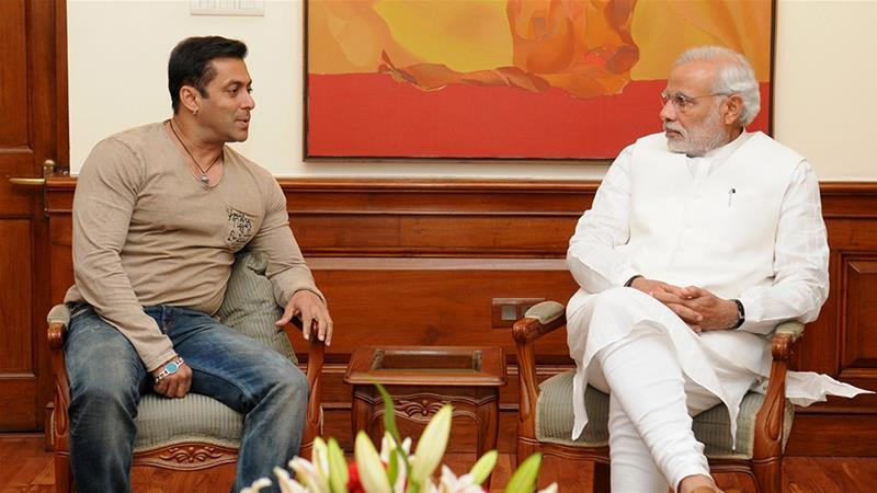In this November 7, 2014 photo, Modi, right, speaks with Bollywood actor Salman Khan in New Delhi [Handout/AFP]