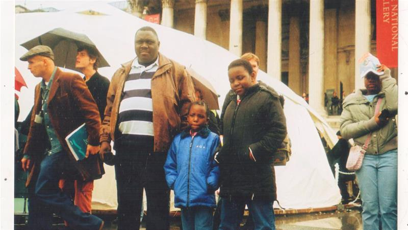 The writer with her sister and father in Trafalgar Square, London, in 2006 [Photo courtesy: Danai Nesta Kupemba]