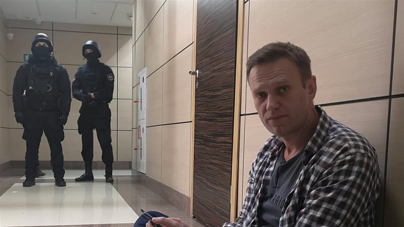 Navalny was detained when police forced their way into his organisation's office, according to his spokeswoman [Alexander Golovach/Handout via Reuters]