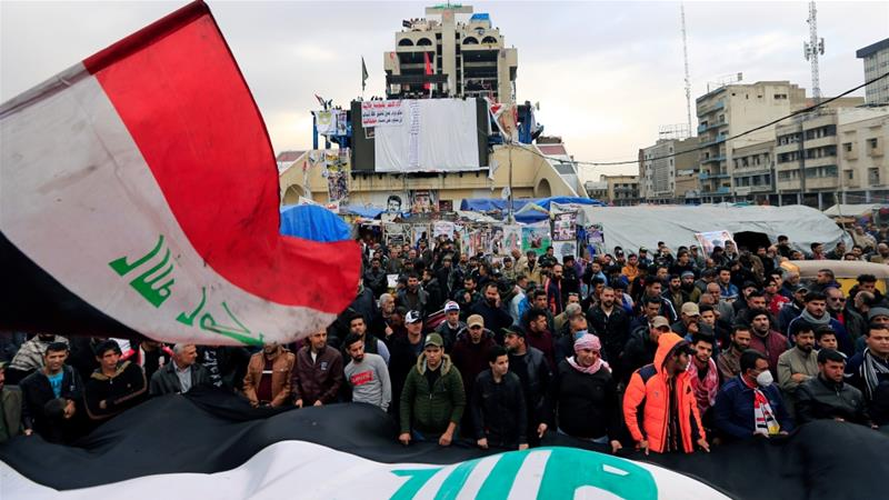 Iraqi demonstrators participate in anti-government protests in Baghdad on December 27 [Thaier al-Sudani/Reuters]
