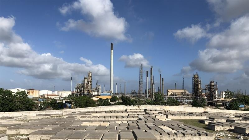 The Isla oil refinery in Curacao, as seen from the cemetery west of the complex towards which pollutants have been emitted for decades [Ben Piven/Al Jazeera]