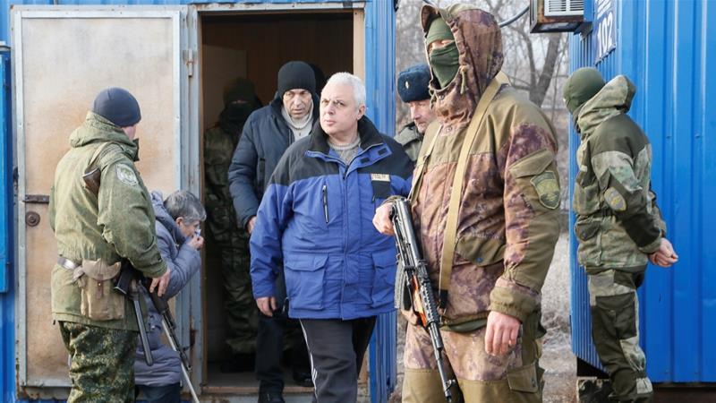 Ukraine, eastern rebels swap prisoners in move to end war