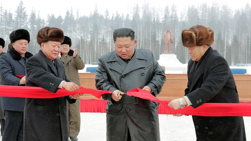 Kim Jong Un cuts a ribbon to launch the township of Samjiyon, a signature project completed despite biting sanctions [KCNA via Reuters]