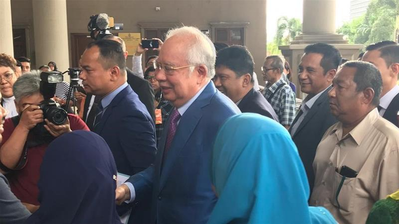 Malaysia's former prime minister Najib Razak arrives in court on Dec 3 where he is expected to give evidence in his own defence [Manar Al Adam/Al Jazeera]