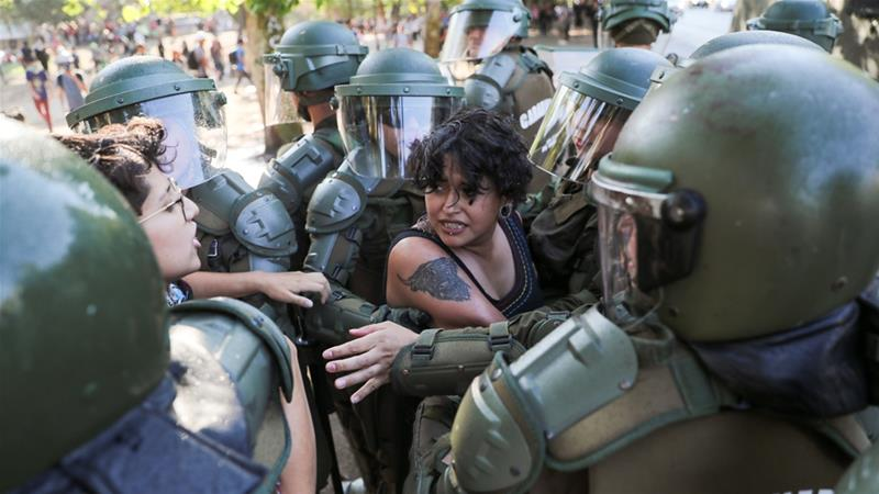 A demonstrator is detained by members of the security forces during a protest against Chile's government in Santiago, Chile [File: Ivan Alvarado/Reuters]
