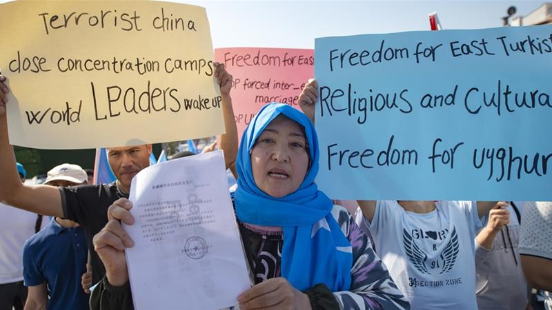 Supporters of China's Muslim Uighurs protest in front of the Chinese consulate in Istanbul last year [File: Yasin Akgul/AFP]