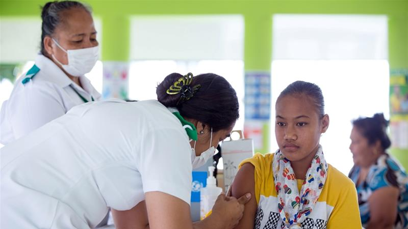 A mass immunisation drive has lifted Samoa's measles vaccination rate to 90 percent, but with the vaccine taking as long as two weeks to take effect the epidemic might not have peaked [Allan Stephen/UNICEF via AFP]