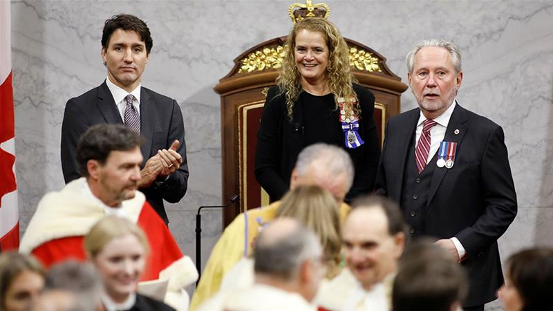 Canada's Prime Minister Justin Trudeau claps his hands next to Canada's Governor General Julie Payette in the Senate, as Parliament prepares to resume for the first time after the election in Ottawa, Ontario [Blair Gable/Reuters]