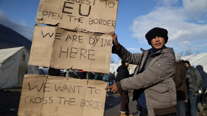 A migrant holds a message for the EU at the Vucjak migrant camp near Bihac, Bosnia and Herzegovina [Antonio Bronic/Reuters]