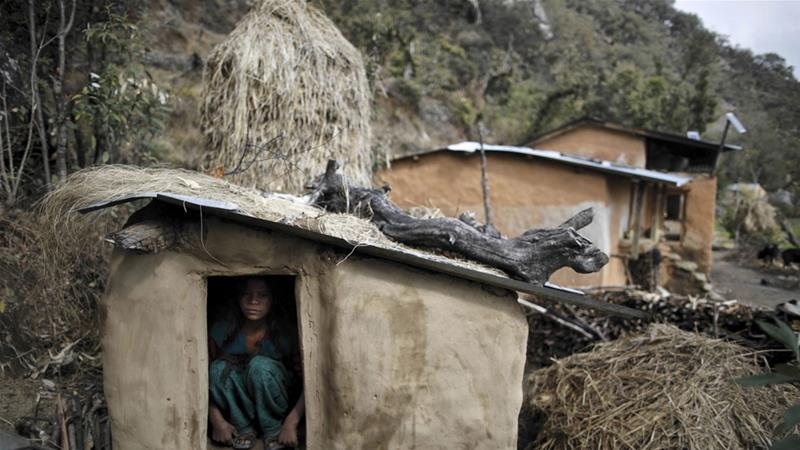 Chhaupadi is prevalent in Nepal's remote west where some communities fear misfortune unless menstruating women and girls are sent away to animal sheds or huts [File: Navesh Chitrakar/Reuters]