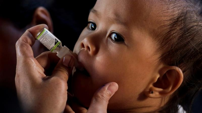In this file photo, a child receives a free polio vaccine during a government-led mass vaccination programme in the Philippines [File: Eloisa Lopez/Reuters]