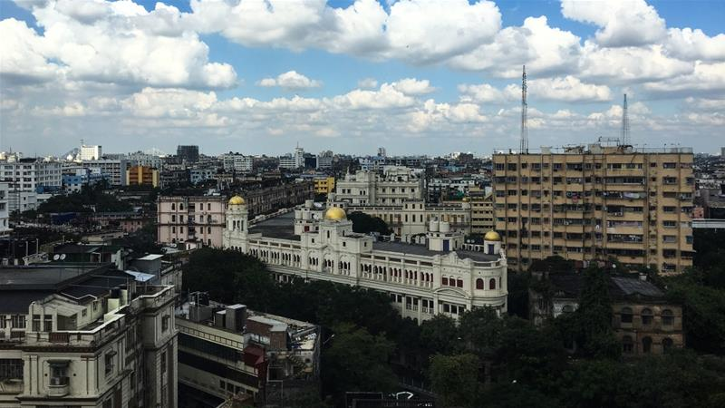 The Kolkata skyline with Park Mansions in the foreground; the protected 1910 building today houses the Goethe Institut, Alliance Française du Bengale and a Starbucks [Neha Banka/Al Jazeera]