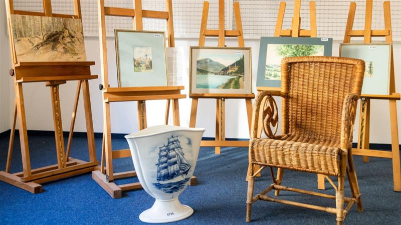 Among the items that failed to sell was a painting of a mountain lake view and a wicker armchair with a swastika symbol presumed to have belonged to Hitler [File: Daniel Karmann/ AFP]