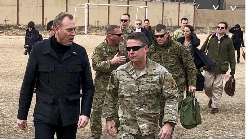 The acting defense secretary (left) says the US has 'strong security interests in the region' [Robert Burns/AP]