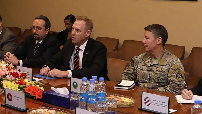 Patrick Shanahan (c) flew into Baghdad from Afghanistan, where he met US troops and Afghan leaders [File: Afghan GMIC via AFP]