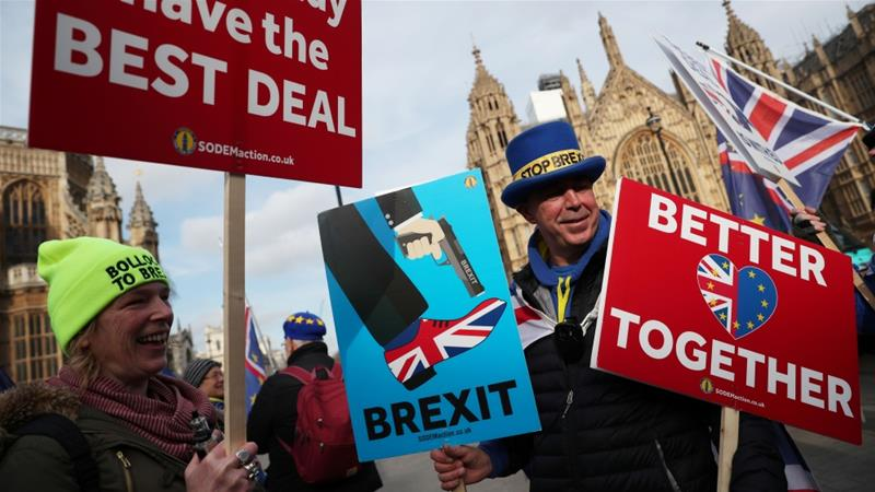 Anti-Brexit demonstrators protest outside the Houses of Parliament, in Westminster, London on February 13, 2019 [Hannah Mckay/Reuters]