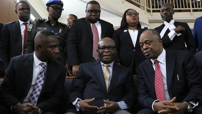 Suspended Chief Justice of Nigeria Walter Onnoghen, centre, talks to his lawyer on Friday [AFP]
