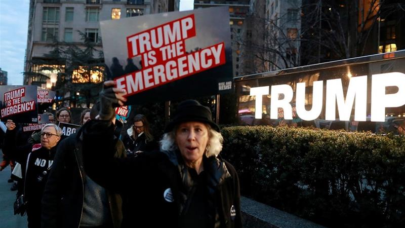 People gather to protest against Trump's declaration of a national emergency at Trump International Hotel & Tower in Manhattan [Andrew Kelly/Reuters]