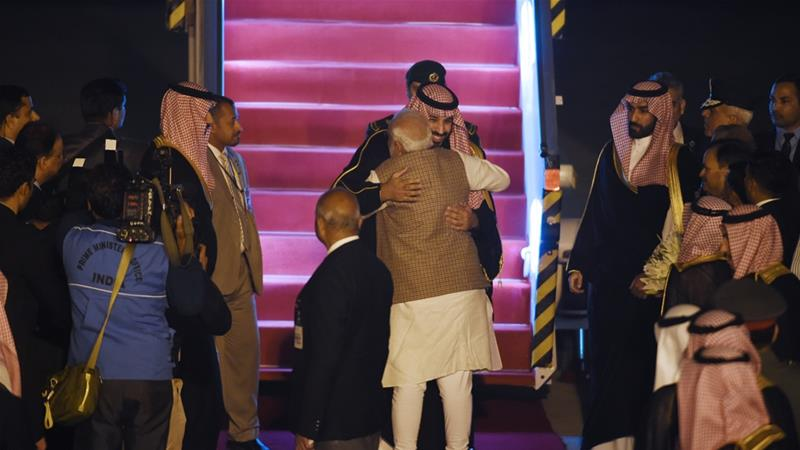 Indian Prime Minister Narendra Modi welcomes Saudi Crown Prince Mohammed bin Salman at New Delhi airport [Money Sharma/AFP]