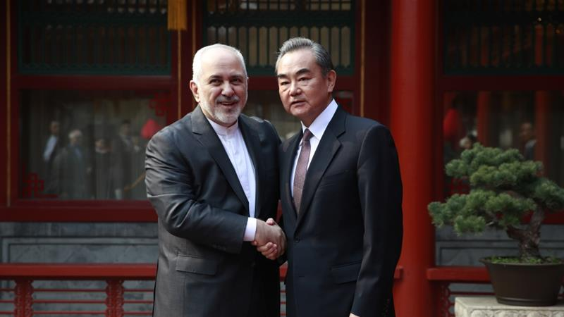 Iranian Foreign Minister Mohammad Javad Zarif and his Chinese counterpart Wang Yi meet in Beijing [How Hwee Young/Getty Images]