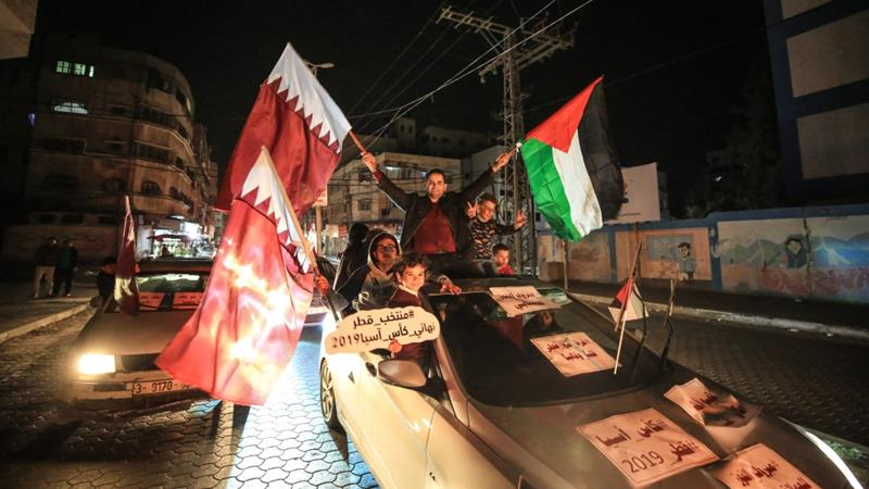 Football fans in the Gaza Strip launched an all-night celebration after Qatar's win carrying Qatari and Palestinian flags [File: Anadolu]