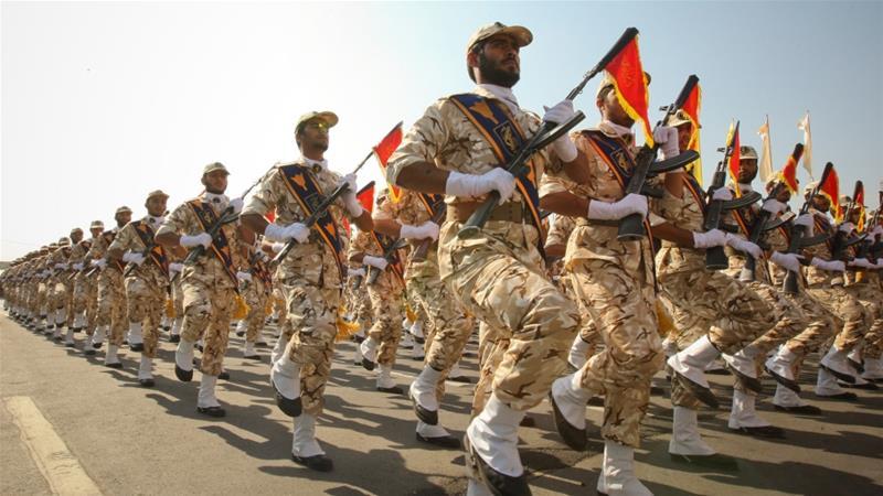 One guard dead, 5 hurt in attack on Iran revolution anniversary