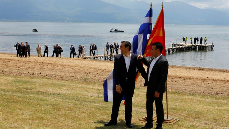 Macedonian Prime Minister Zaev and Greek PM Tsipras speak after the signing of an accord to settle the Macedonian name dispute on June 17, 2018 [File: Ognen Teofilovski/Reuters]