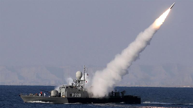 An Iranian navy warship test fires a new long-range missile during annual exercises in 2012 [Ebrahim Noroozi/EPA]