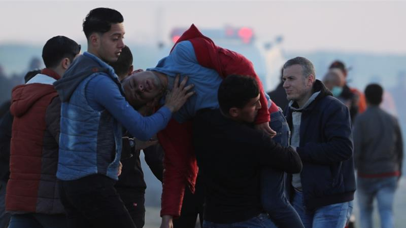 A wounded Palestinian is evacuated during a protest at the Israel-Gaza border fence, east of Gaza City on February 22, 2019 [Mohammed Salem/Reuters]