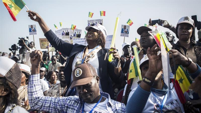 Supporters of Senegalese President Macky Sall cheer as he speaks at a rally in Dakar on Sunday [Jane Hahn/AP Photo]