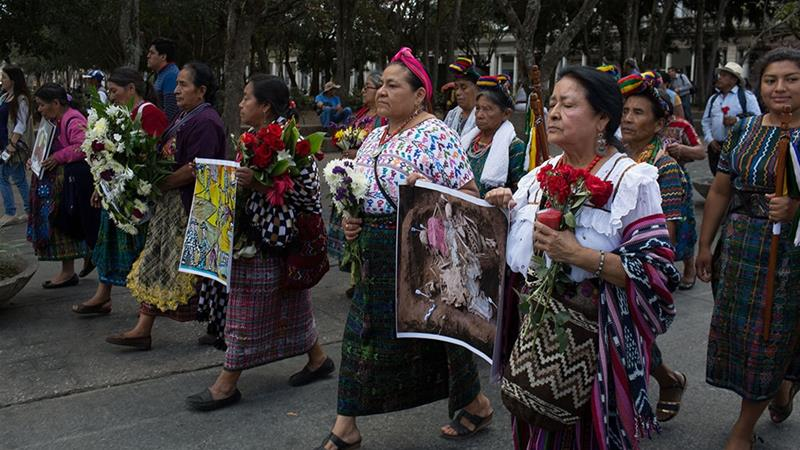Rigoberta Menchu marches alongside the widows of the Guatemalan internal armed conflict [Jeff Abbott/Al Jazeera]