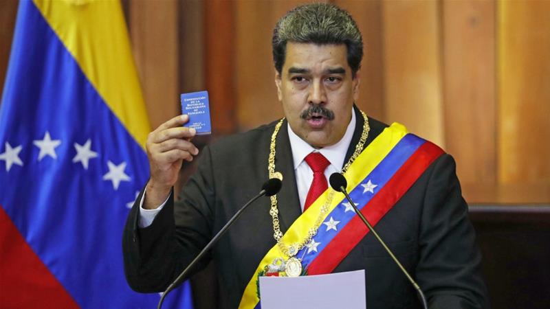 Venezuela's President Nicolas Maduro holds up a small copy of the constitution as he speaks during his swearing-in ceremony in Caracas, Venezuela on January 10, 2019 [File: AP/Ariana Cubillos]