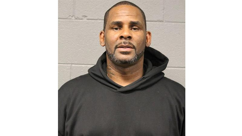 In this photo taken and released by the Chicago Police Department on February 22, R&B singer R Kelly is photographed during booking at a police station in Chicago [File: Chicago Police Department/AP]