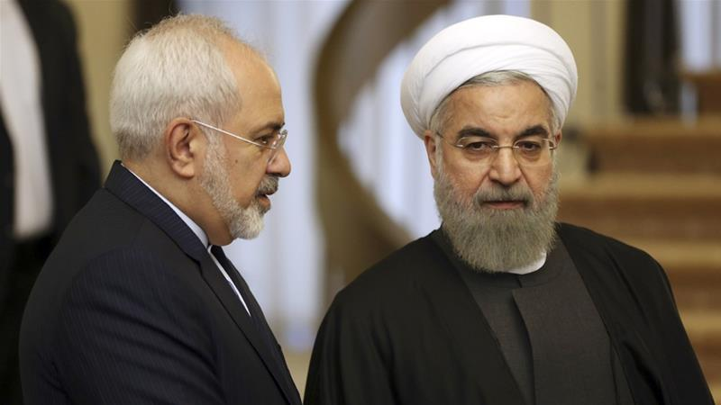 Iranian President Hassan Rouhani, right, rejected Foreign Minister Mohammad Javad Zarif's resignation [Vahid Salemi/AP]