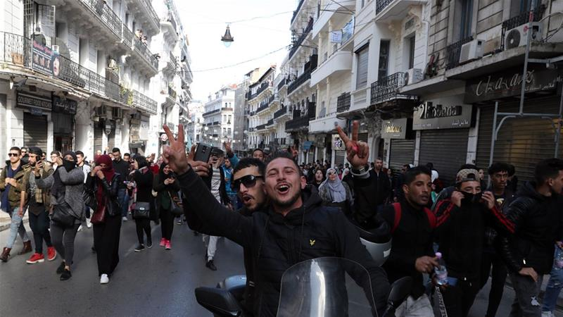 Algerian students protest against Abdelaziz Bouteflika re-election plans in Algiers on Tuesday [Mohamed Messara/EPA-EFE]